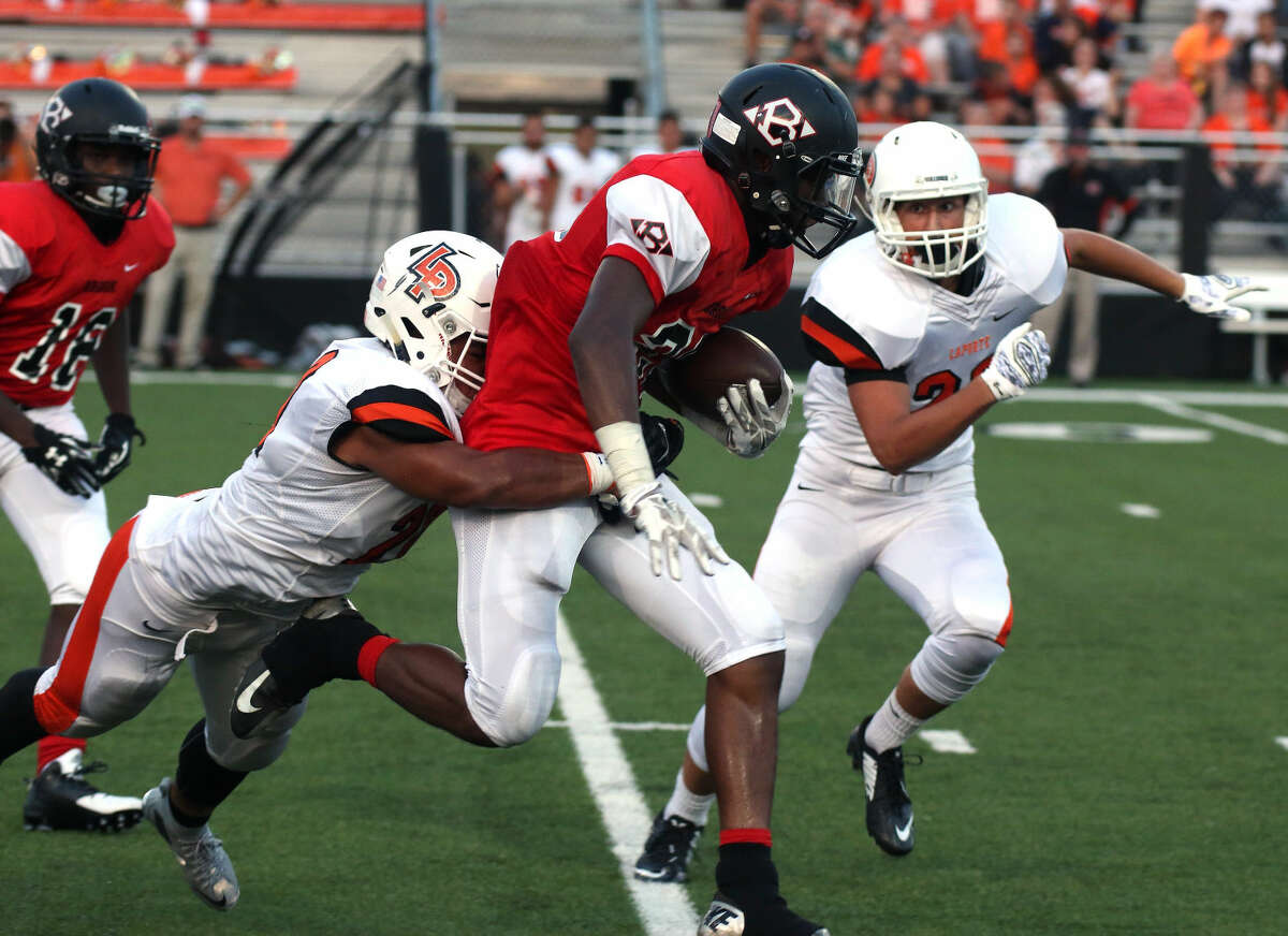 Clear Brook's Tywon Mackey (20) runs through La Porte players Thursday night.