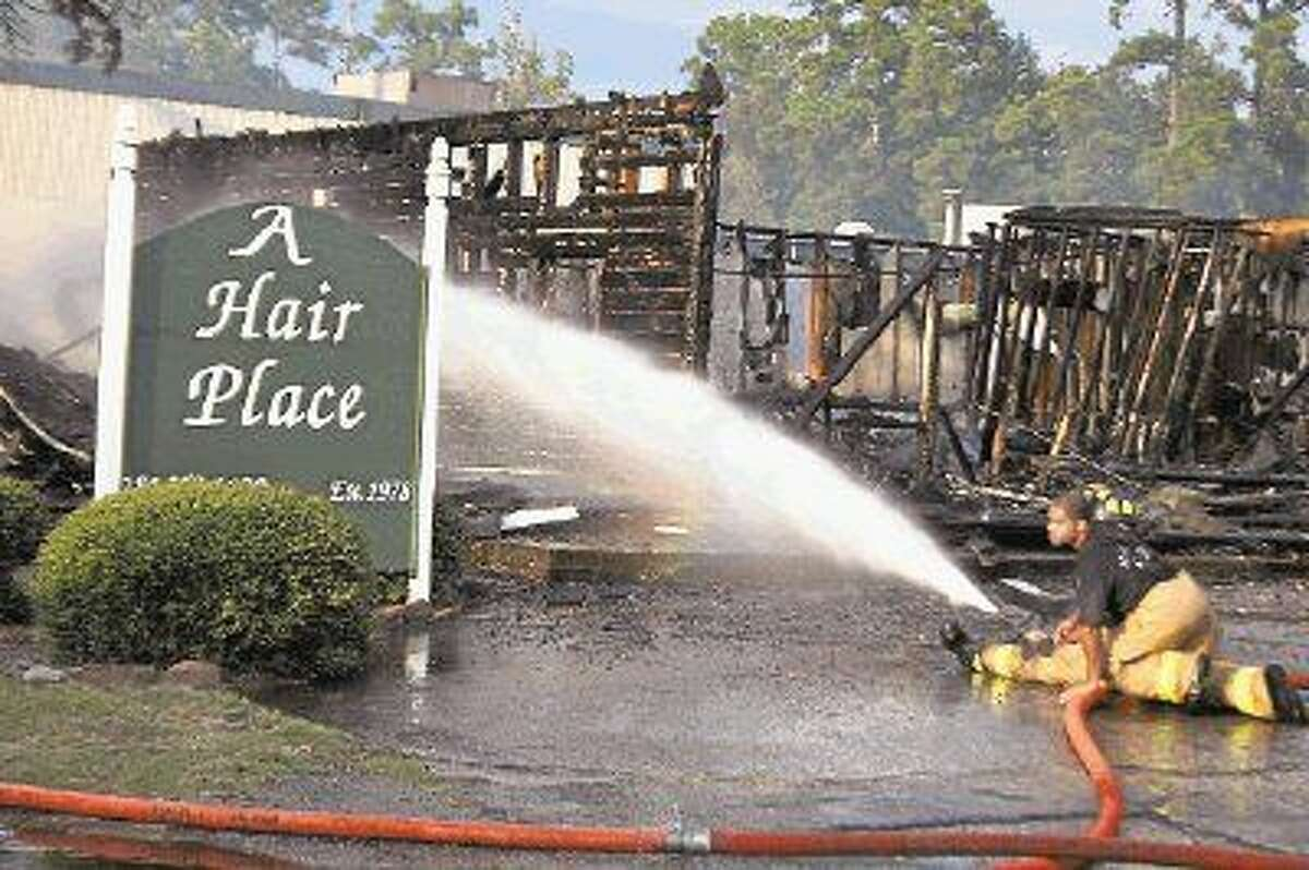 A Hair Place was destroyed after a fire ripped through their building Monday, Aug. 17, 2015.