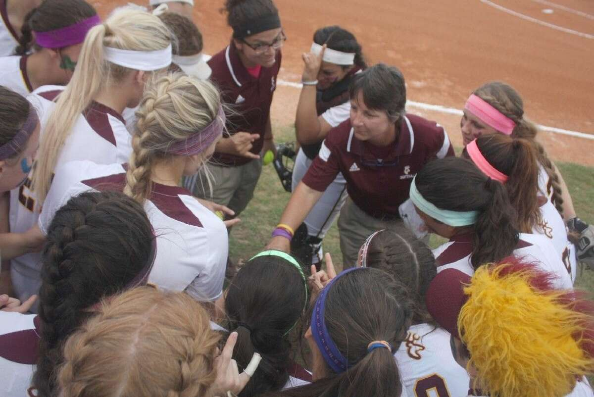 Carrie Austgen gets the squad pumped up for the Dobie game last week. She shouldn't have any problem getting them pumped for Ft. Bend Travis since the Area round is where the Lady Deer got eliminated last May.
