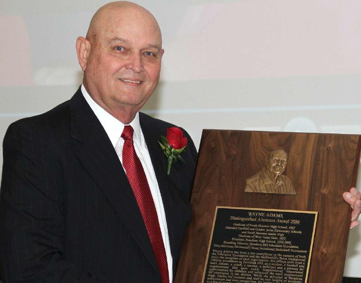 Adams with the Pasadena ISD 2016 Distinguished Alumnus award.