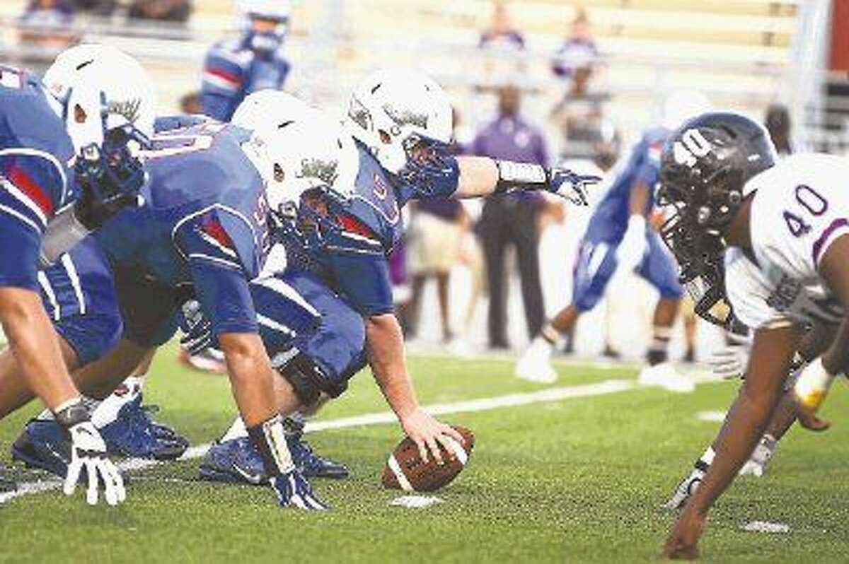 Oak Ridge's offensive line faces off with Morton Ranch last season.