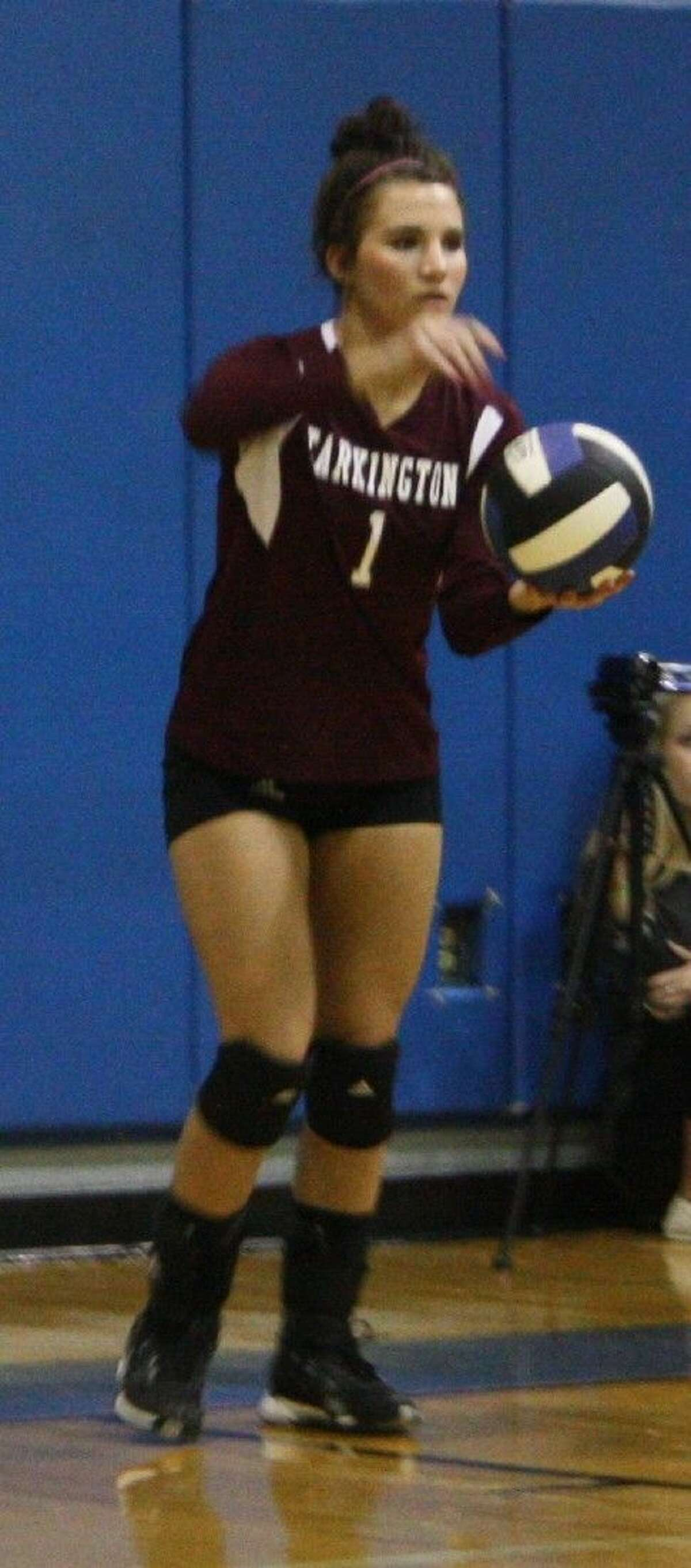 Paige Montgomery prepares to serve the ball to the Lady Pirates.