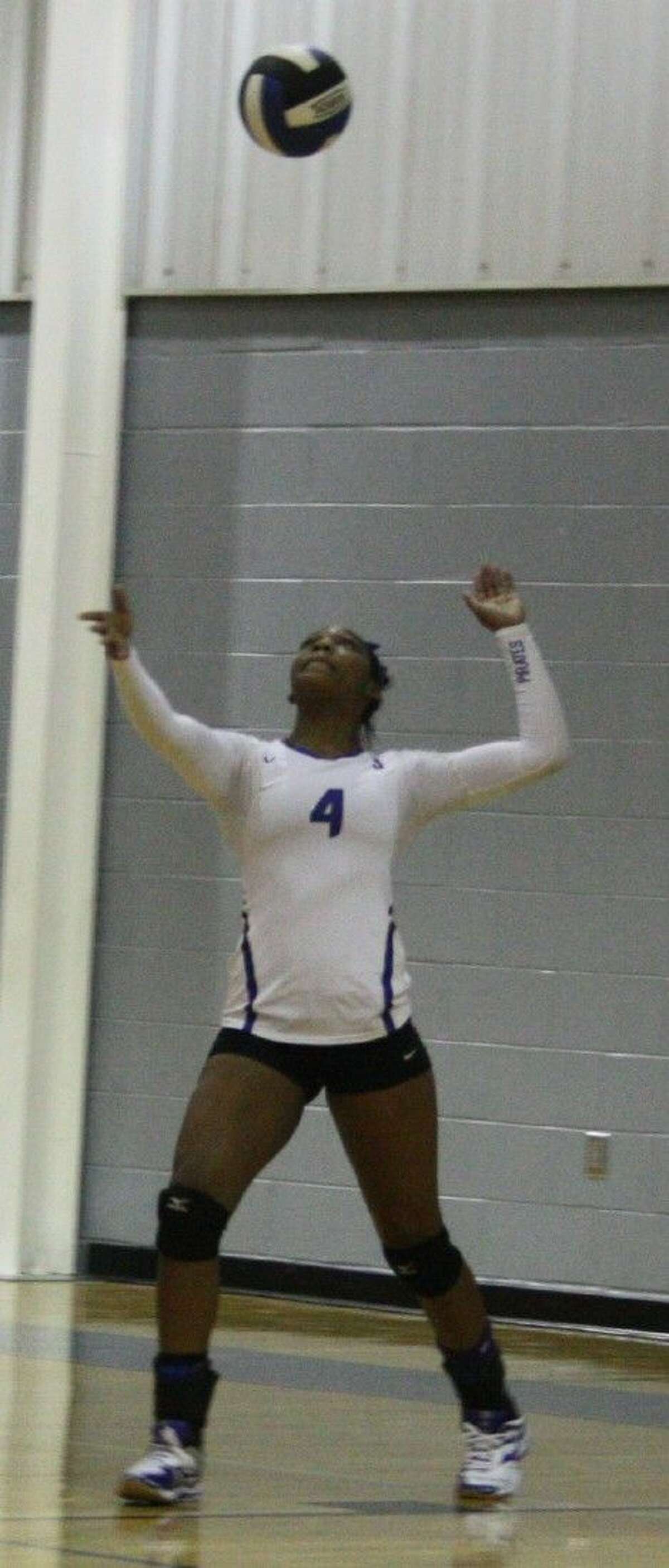 Danielle Skinner waits for a falling volleyball in order to make a serve to the Lady Horns.