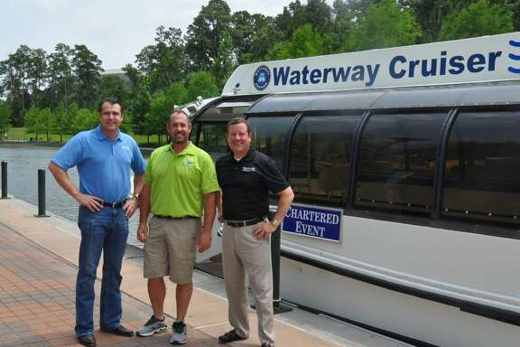 Chairman of The Woodlands Convention and Visitors Bureau, Gordy Bunch, alongside new owner and operator of Waterway Events, LLC, Captain Michael Wilson, and President of The Woodlands Convention and Visitors Bureau, Nick Wolda.