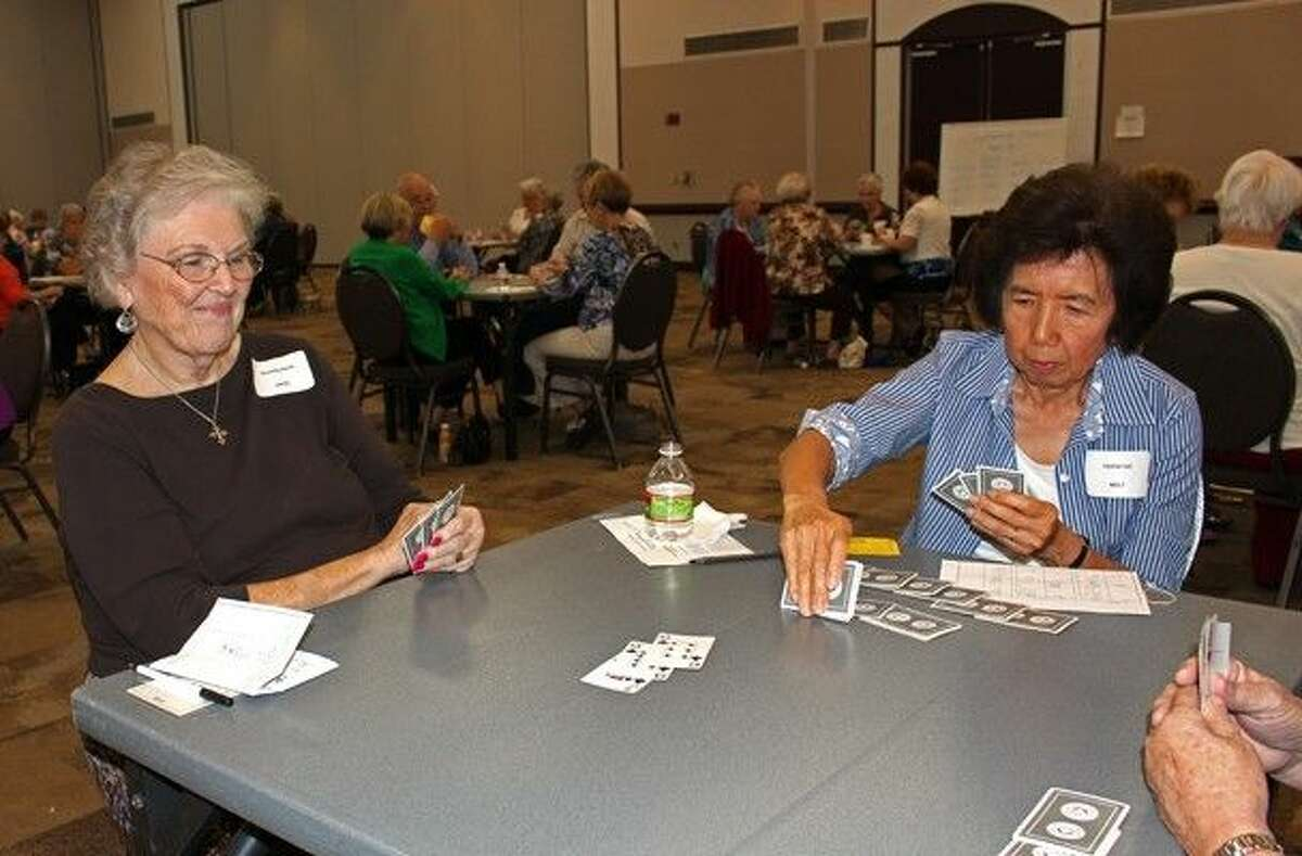 Pictured, Beverly Jarvis and Louise Lui compete for prizes during the Sept. 17 Sweet Deal Party Bridge Tournament.