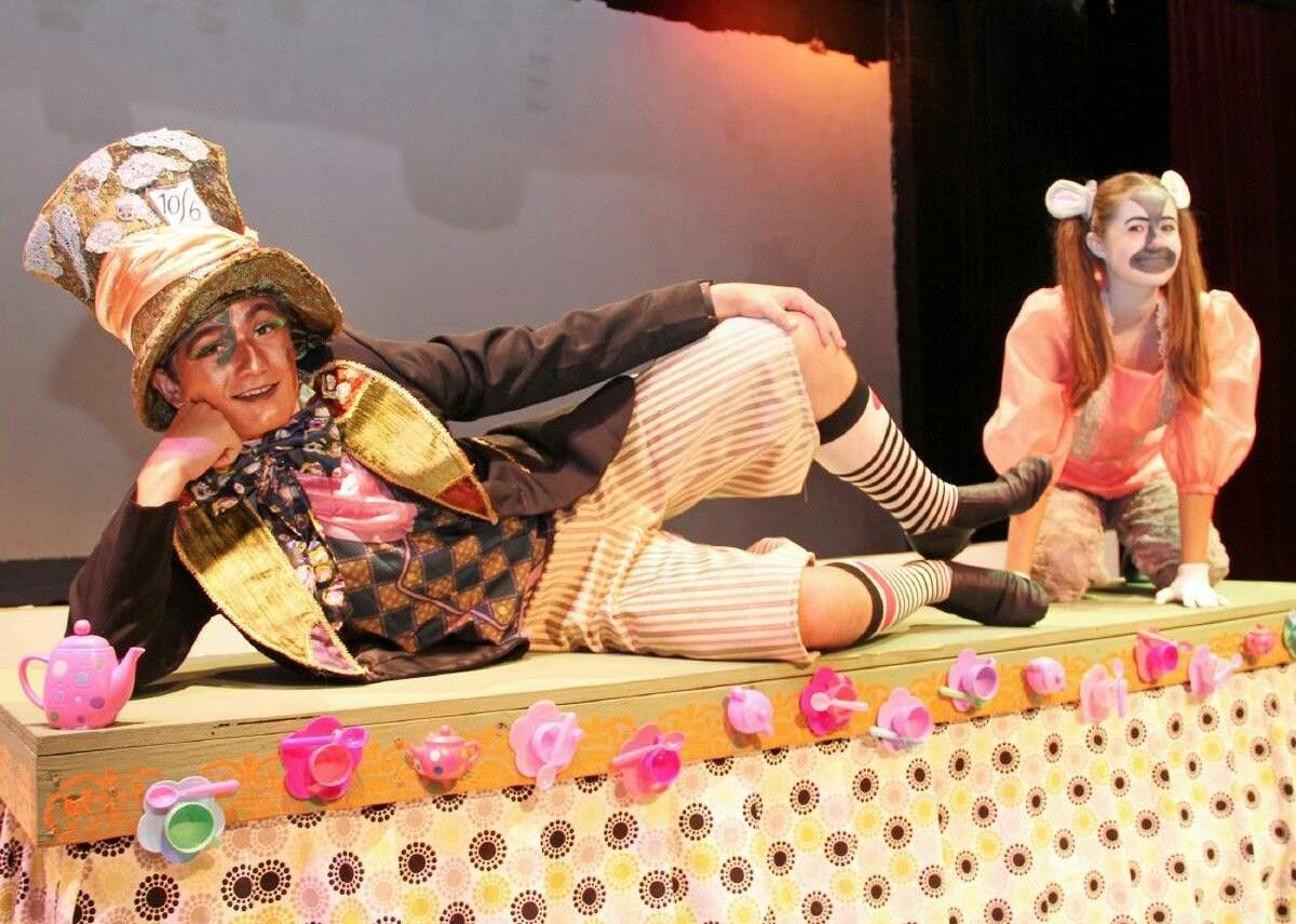 The Mad Hatter (Emmanuel Martinez) and the Dormouse (Meg Court) prepare for a tea party in Pearland High School's production of
