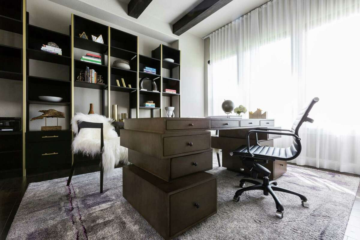 Momin has to feel like the epitome of a modern woman when she does the books from her optometry practice from her home office. She's got a modern desk with offset drawers, a custom-made bookcase full of photos and objets d'art, plus furry throws over two armchairs.