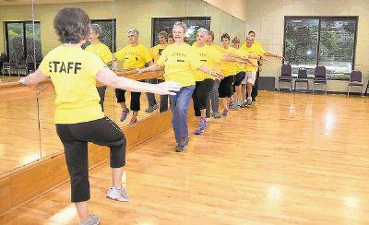 LiveStrong program facilitator Mary Anne Frost leads a group of survivors in a barre exercise. The 12-week program for cancer survivors and their caregivers begins Sept. 14 a the Shadowbend YMCA.
