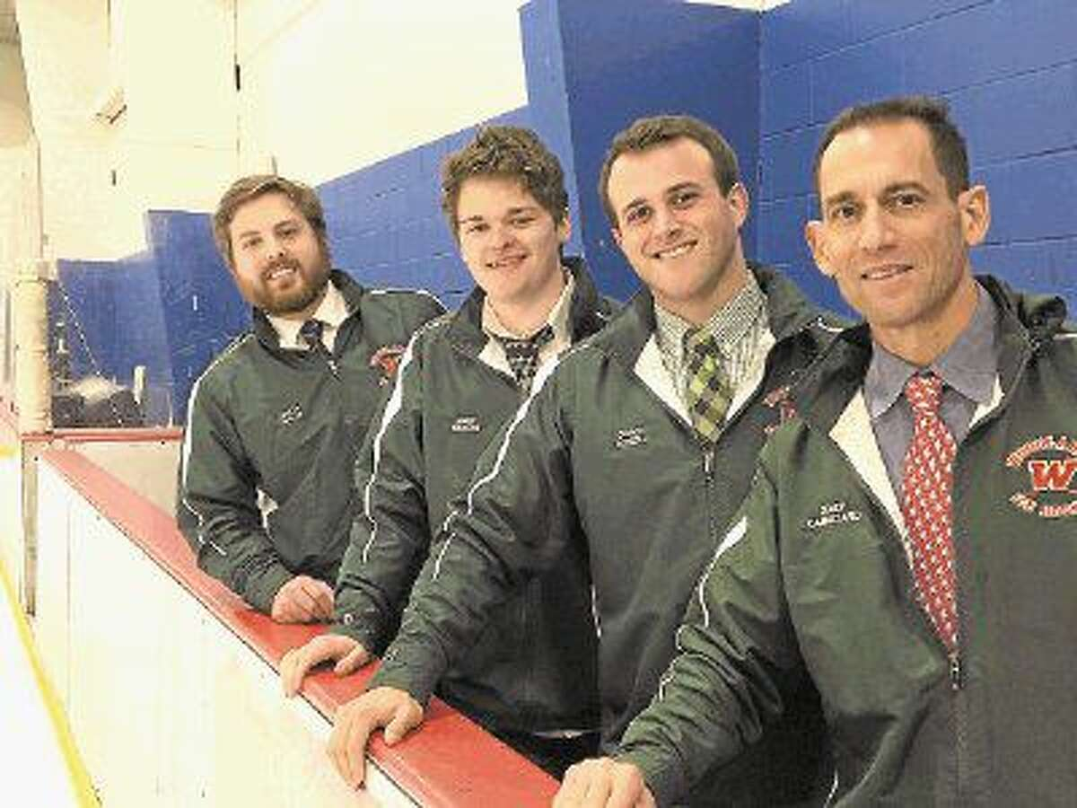 The Woodlands Hockey coaching staff poses for a photoe. From left to right: assistants Jonathan Chalos, Wes Gilmore, Nick Sokoll, and head coach Carl Cannizarro. Sokoll will replace Cannizarro as head coach next season.