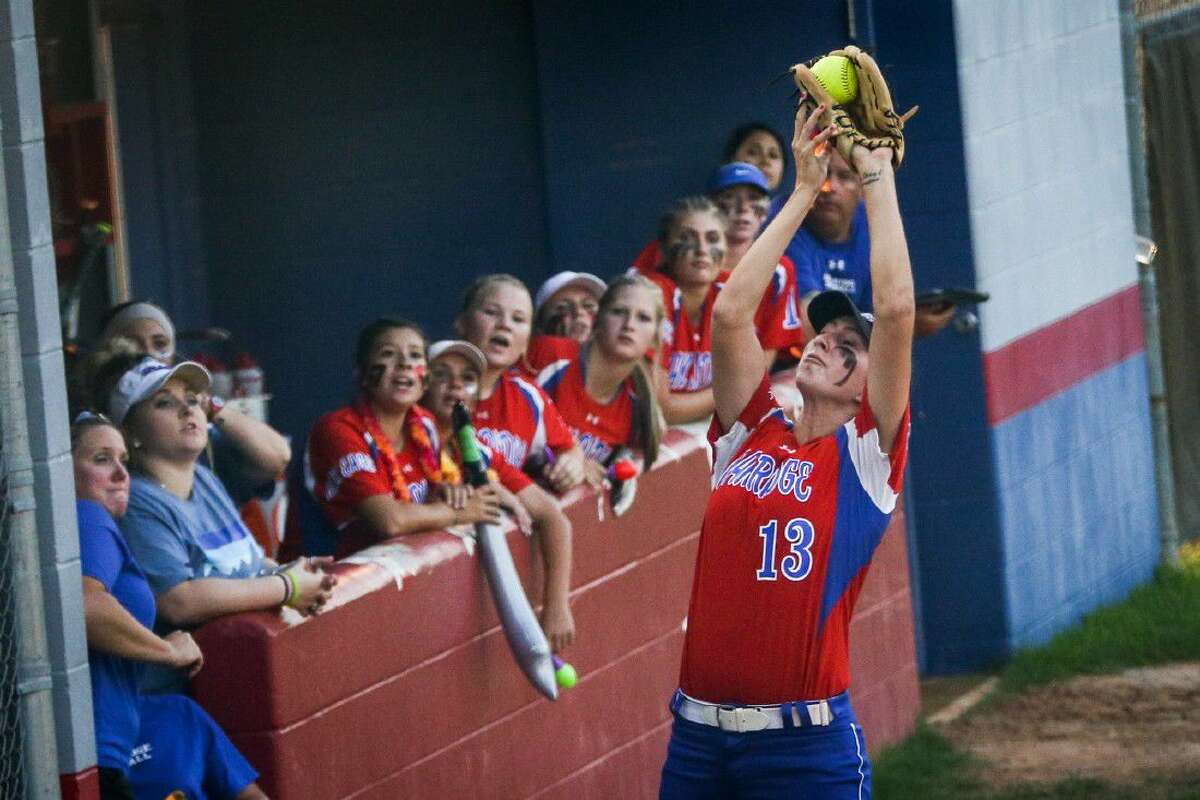 Oak Ridge's Amanda Cunniff (13) catches a fly ball during the high school softball game against Austin Bowie on Friday, May 6, 2016, at Oak Ridge High School. To view more photos from the game, go to HCNPics.com.