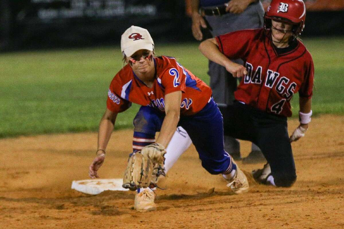 Oak Ridge's Cheyenne Cavanaugh (2) catches the ball but is off base during an Austin Bowie steal at second base during the high school softball game on Friday, May 6, 2016, at Oak Ridge High School. To view more photos from the game, go to HCNPics.com.