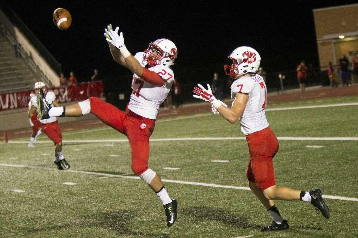 Katy defensive back Collin Wilder attempts to intercept a pass against Kingwood in Week 1. The Tigers defeated Mayde Creek 63-6 in the District 19-6A opener.