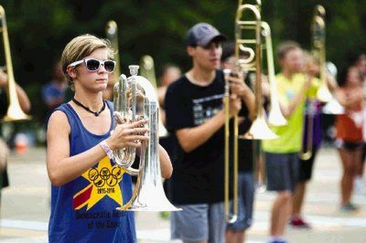 College Park band students practice in the school's parking lot after school. The band has been working since early August on drill, form and memorizing music to prepare for the 2015 competition season.