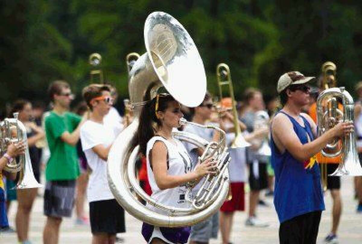 The College Park Marching Band students stay after school for practice after a rainstorm came through earlier in the day, making the August heat more bearable.