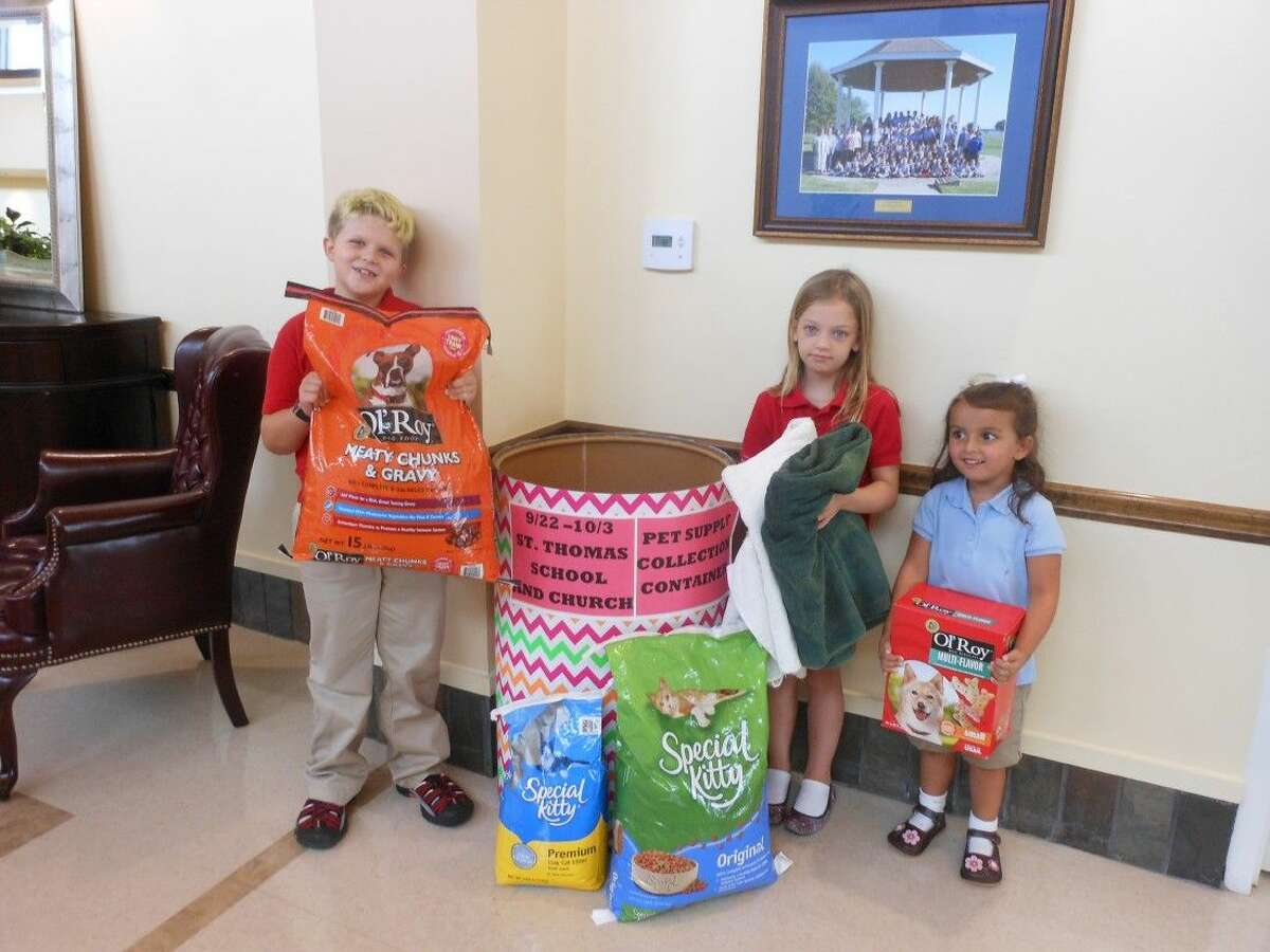 St. Thomas the Apostle Episcopal School's Pet Supply Drive is taking place Sept. 22 - Oct. 3, culminating in delivery on Oct. 4 at the St. Thomas the Apostle Episcopal Church's annual Family Fun Fest and 5 K. At the Pet Blessing, scheduled for 9:30 a.m. on Oct. 4, the supplies collected will be donated to Bay Area Pet Adoptions. The picture includes the following children: on the left, Jett Strack, a 4th grader, on the right next to the barrel, Megan Davis, a 2nd grader, and on the right at the end, Ansley Wadle, a PreK-3 Mariner.