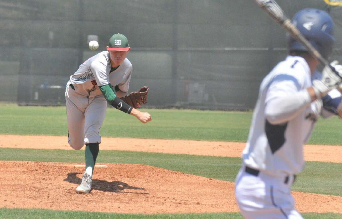The Woodlands' Devin Fontenot delivers a pitch against Klein Collins in Game 2 of a bi-district playoff series at College Park High School on Saturday.