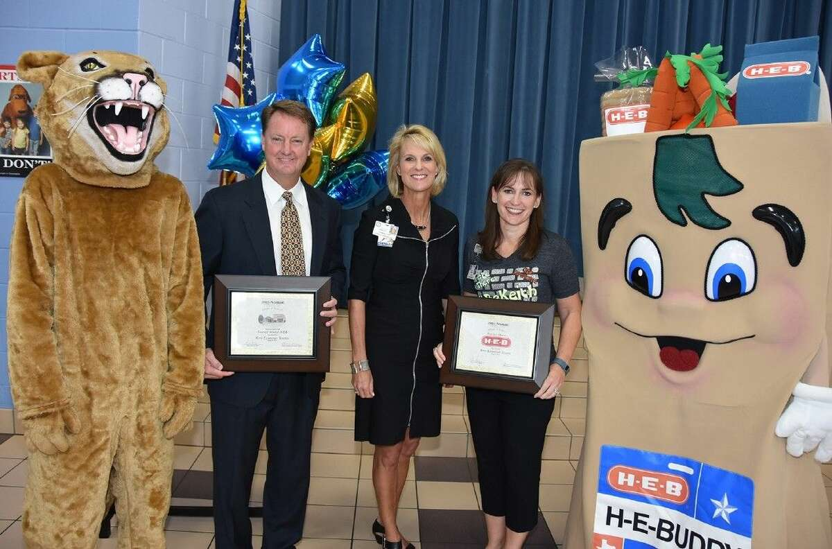 Joined by the Keith Cougar mascot and H-E-Buddy, (L-R) David Hamilton, H-E-B Fairfield Market general manager; Leslie Francis, CFISD director of marketing and business relations; and Cheryl Fisher, Keith Elementary School principal celebrate an Adopt-a-School partnership on Aug. 21.