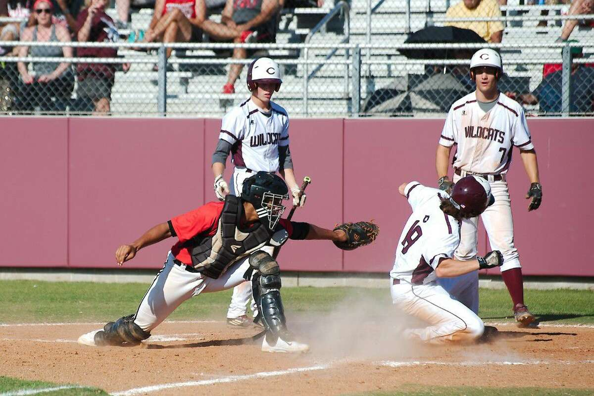 FB Austin's Paul McRae (35) is unable to make the tag as Clear Creek's Reed Hamilton (19) slides safely into home plate Saturday.