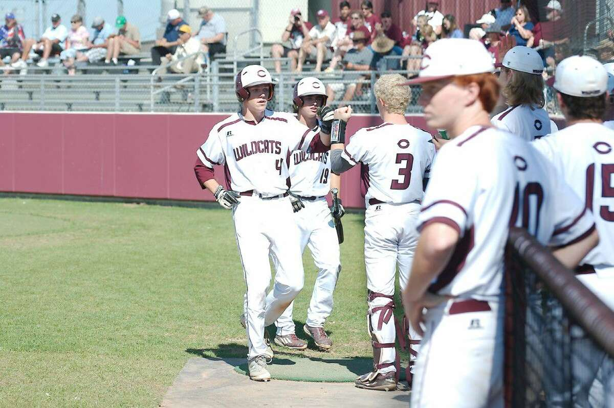 Clear Creek's Jack Kelly (4) gets a fist bump from teammate Parker Osburn (3) after scoring a run against FB Austin Saturday.