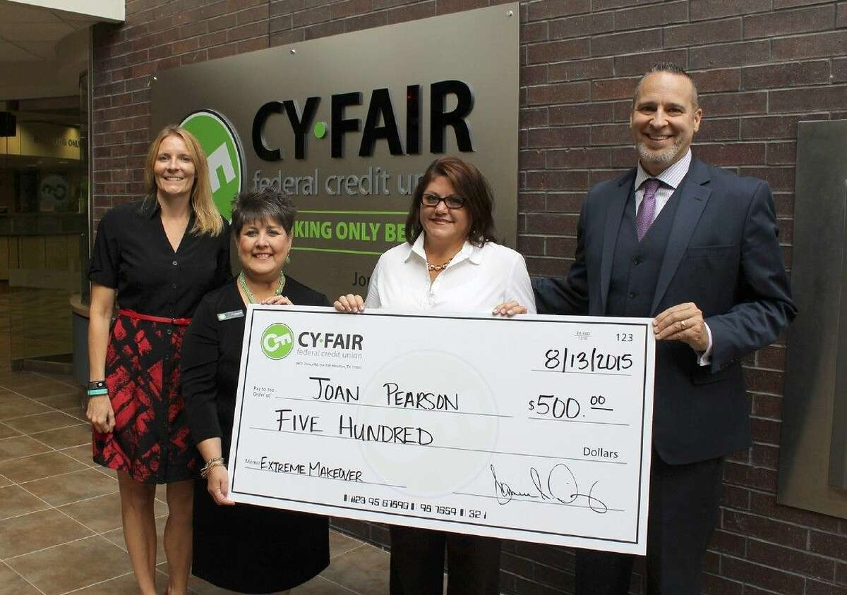 Hamilton Middle School teacher Joan Pearson, third from left, accepts her 500 prize from the Cy-Fair Federal Credit Union Middle School Extreme Makeover - Classroom Edition contest. Also pictured (L-R) are Valarie Brittain, CFFCU vice president of human resources; Alice Wimberly, CFFCU chairman of the board; and Cameron Dickey, CFFCU president and CEO.