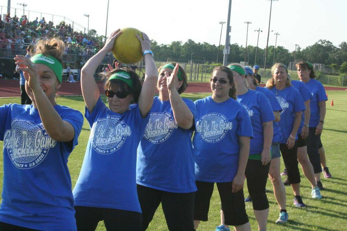 Bear Branch Elementary teachers practice their over-under which was the determining factor as to which team would get the opportunity to select whether they would kick or receive first.