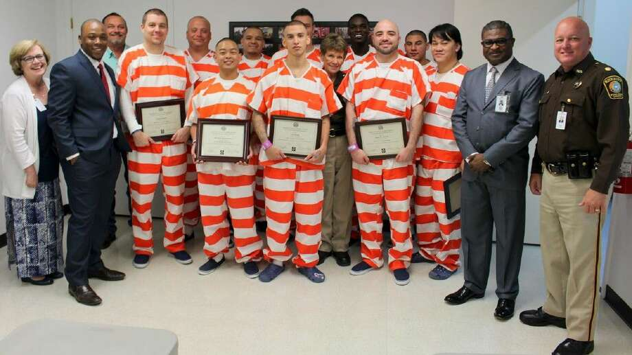 Inmates in the fourth class of the Fort Bend County Sheriff's Office H-VAC/Electrical program received certificates of completion during ceremonies held May 6. Shown with the inmates are Alice Atkins of WCJC; Dejashatun Williams, Workforce Solutions and guest speaker; David Jeffery, WCJC and the instructor for the course; Sgt. Nadine Sutton (middle); Richard Erivo, Inmate Vocational Administrator and Coordinator; and Major Chad Norvell, who represented Sheriff Troy E. Nehls at the ceremony by presenting certificates to the inmates.