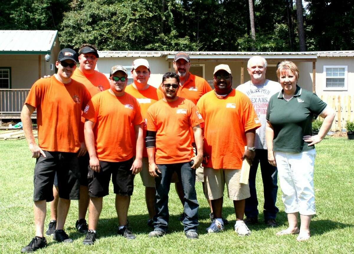 Jenny and Larry Jackson (right) of Hope Cancer Retreat in Splendora posed alongside managerial staff from more than 10 local Home Depot locations during a makeover event on Aug. 27.