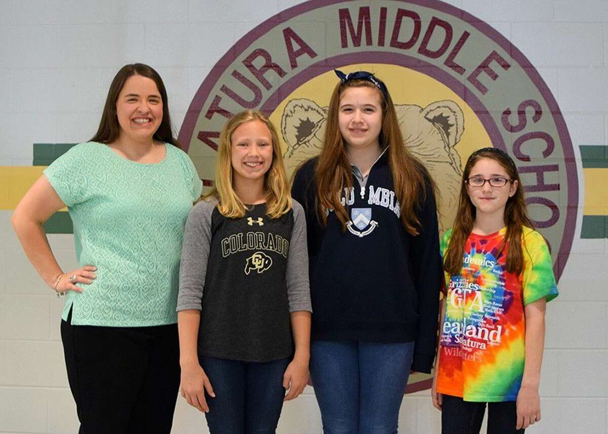 Sablatura Middle School choir director Kelsy Holt (far left) proudly announces three students who made the TCDA State Elementary Honor Choir: (from left) Olivia Bursnall, Taylor Jacksonk and Olivia Moeller.