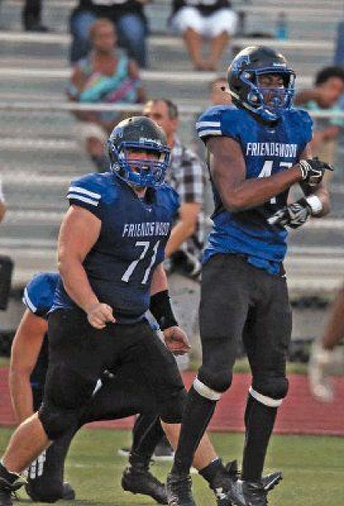 Friendswood's Ian Jones (71) celebrates after teammate Ty Shelby (47) sacked the Texas City quarterback Friday night.