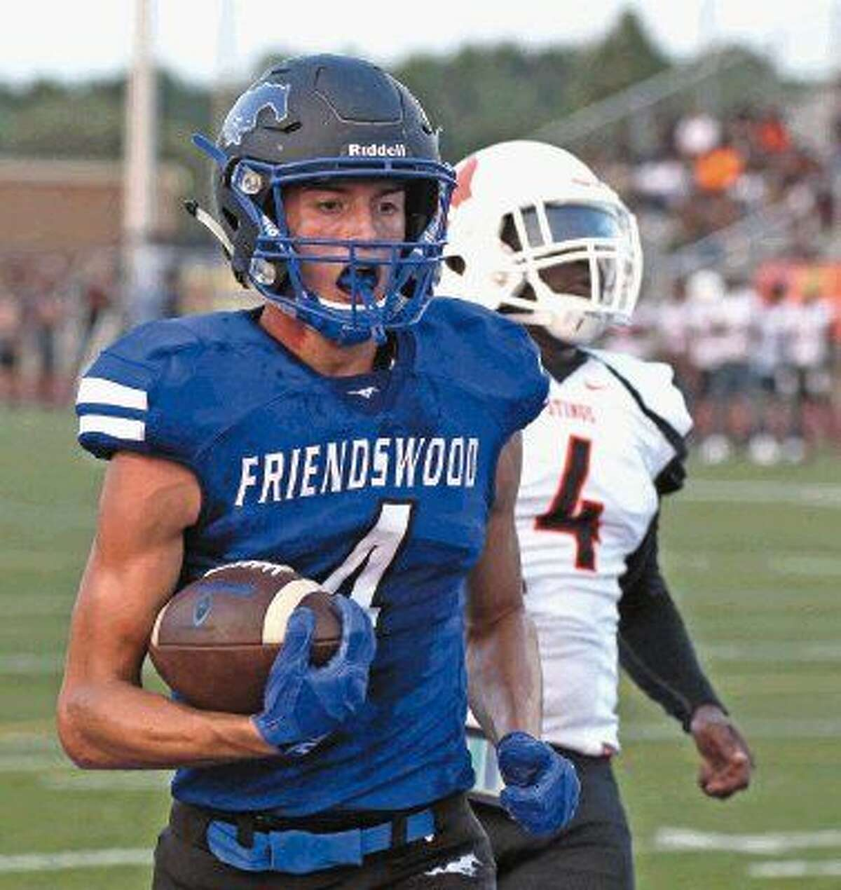 Friendswood's Nick Swaney (4) heads to the end zone on a 32-yard pass reception from Tyler Page for the Mustangs' first touchdown against Texas City Friday night.