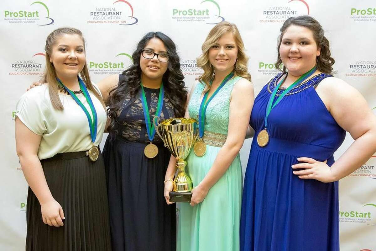 The New Caney High School Culinary Arts ProStart Management Team pose after winning first place at the national ProStart competition Sunday, May 1. From left to right: Kayla Gebauer, Yarumi Guerrero, Hayley Lewis and Mysterie Roberson.