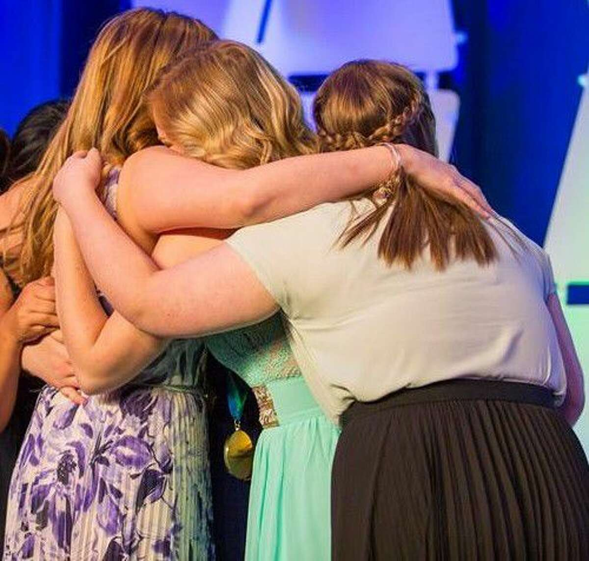 Members of the Culinary Arts ProStart Management Team embrace after being announced the first place winners of the National ProStart competition Sunday, May 1.