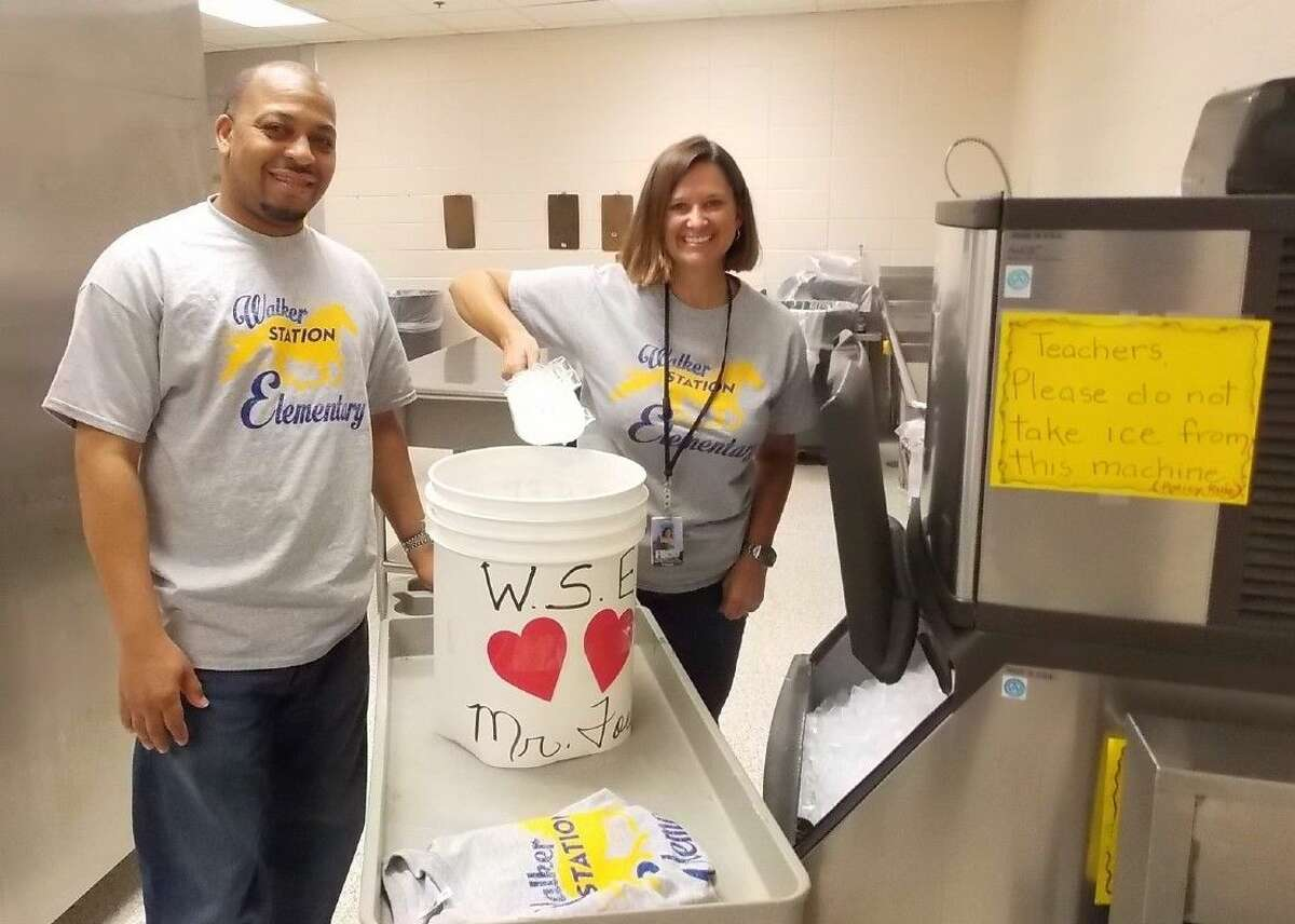 Dr. Lesli Fridge, principal at Walker Station Elementary School (right) and Assistant Principal Greg Granger (left) are shown filling the
