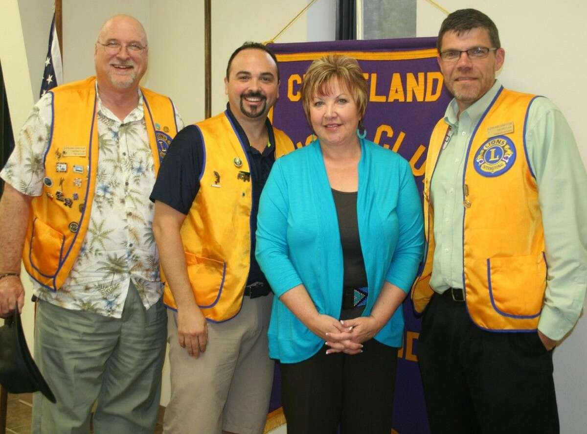 Cleveland Lions Club President Thomas Higgins (right), along with members Tim Holder and Russell Tynan, welcomed guest speaker Jenny Jackson, with Hope Cancer Retreat in Splendora, on Sept. 23.