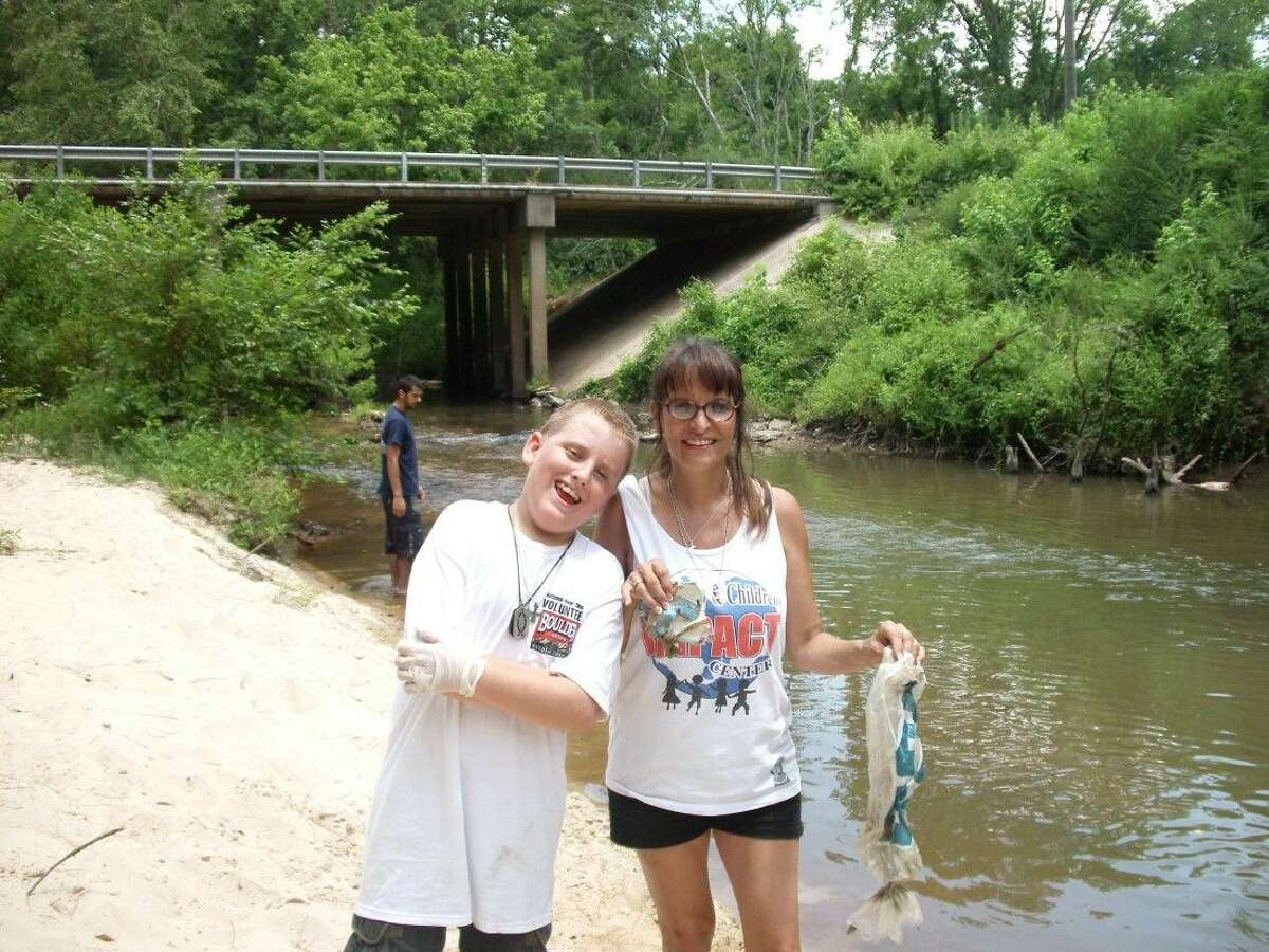 Brenda Myers (right) and Kalvin Doyle (left) work together during National River Cleanup Day.