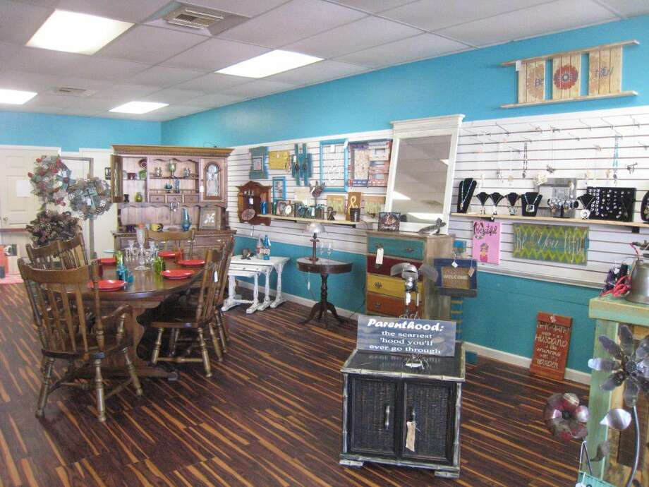 The smell of freshly painted wood and leather greet customers as they walk through Reclaim Country, a newly opened rustic accessories and furniture business located in Atascocita.