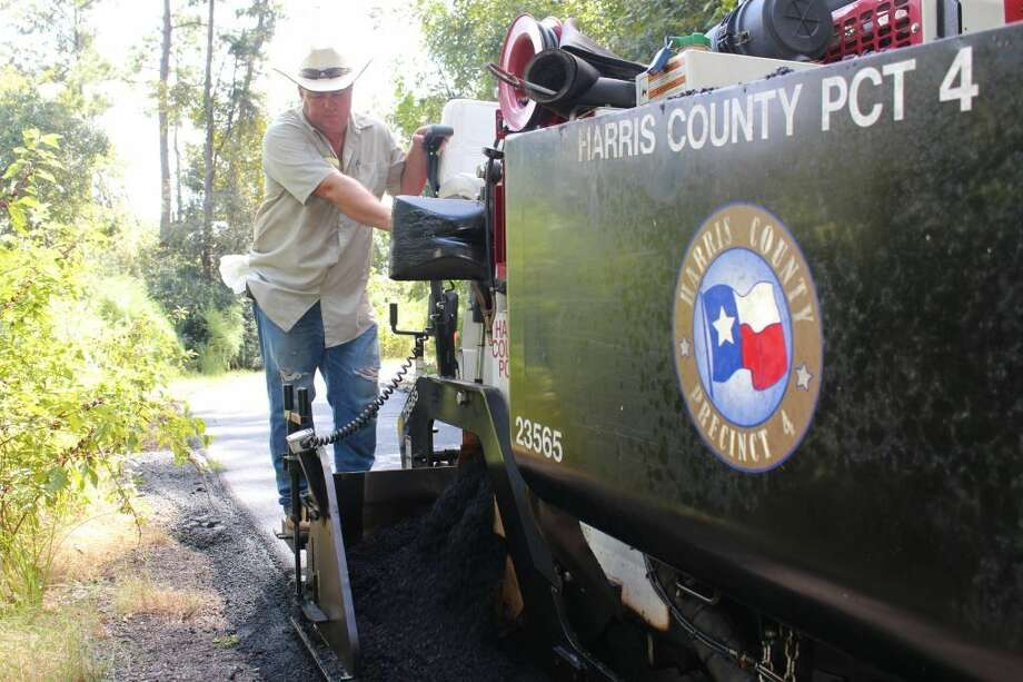 Brad Hill, Precinct 4 projects manager, oversees the trail alignment during the repaving project.