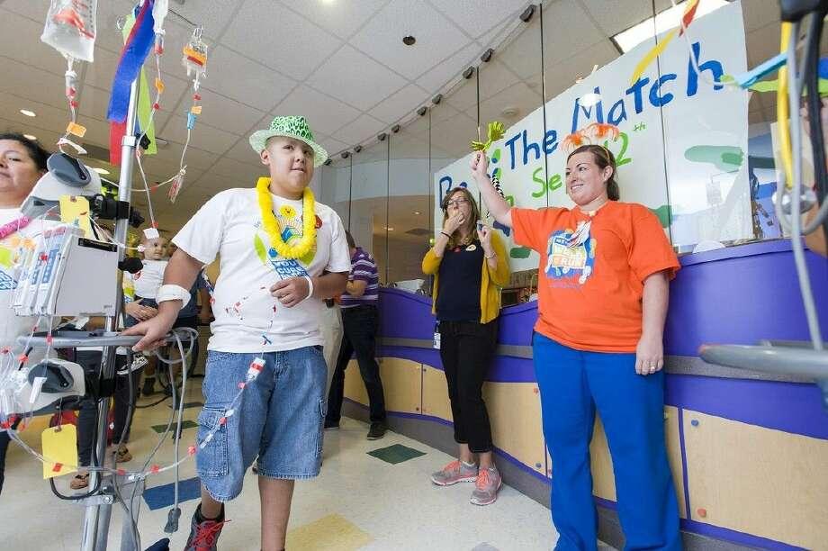 Texas Children's Hospital patient Julio Cruz and Nichole Hurst. Photo:  Allen S.Kramer TCH