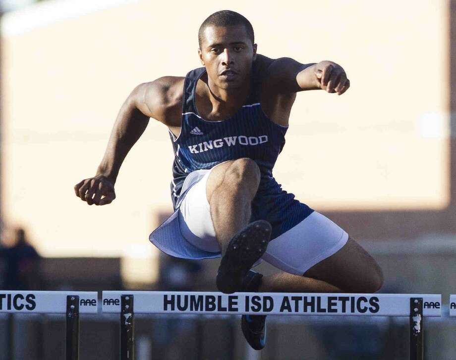 Kingwood's Dominic Swoopes competes in the boys 300-meter hurdles at the Region III area track and field championships at Turner Stadium Friday in Humble. Go to HCNpics.com to purchase this photo and others like it. Photo: Jason Fochtman