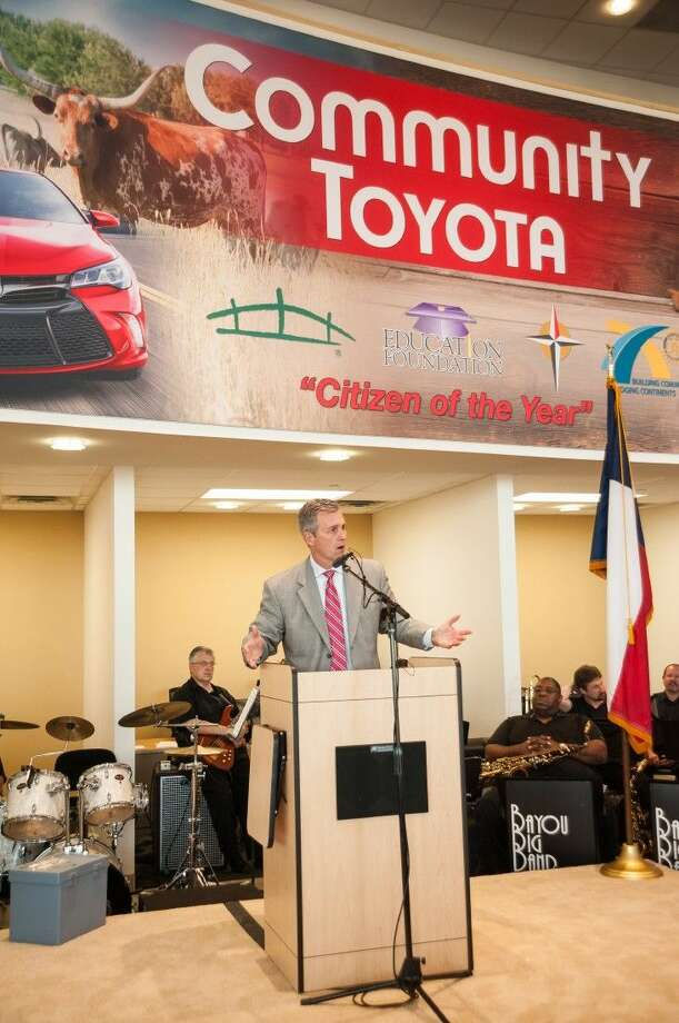 Gulf States Toyota President and General Manager Marty Collins welcomes friends and family to the grand opening celebration of Community Toyota in Baytown. Photo: Barry Champagne