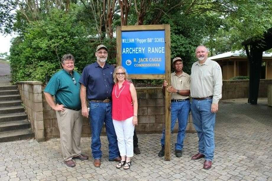 "Commissioner R. Jack Cagle dedicates the archery range at Spring Creek Park in honor of William ""Pepper Bill"" Schiel. Pictured from left to right: Parks Administrator Dennis Johnston, Bill Schiel, Alice Schiel, Michael Curley, and Commissioner Cagle. Photo: Submitted"