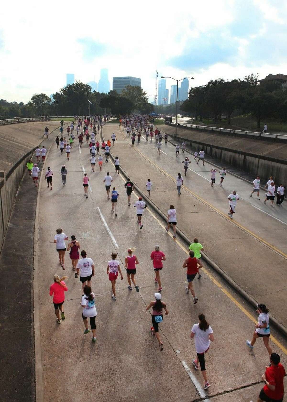 Walkers and runners navigate Allen Parkway in the Komen Houston Race for the Cure in downtown Houston on Saturday, Oct. 6, 2012.