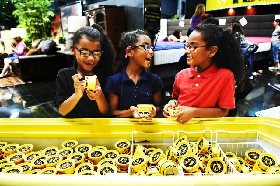 Sisters Tatiyana Lashley, Aaliyah Lashley and I'Aisia Lashley are happy to get their Bule Bell ice cream at Gallery Furniture on Tuesday, Sept. 1, 2015. Photo: Tony Gaines