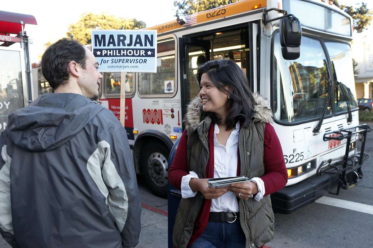 Marjan Philhour, running for Supervisor in District 1, chats with commuters waiting at the bus stop at Geary Boulevard and 25th Avenue in San Francisco, Calif. on Wednesday, Oct. 5, 2016.