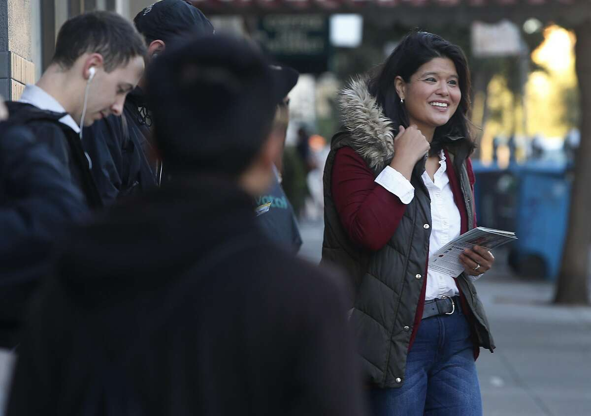 Marjan Philhour, running for Supervisor in District 1, meets and greets voters waiting at the bus stop at Geary Boulevard and 25th Avenue in San Francisco, Calif. on Wednesday, Oct. 5, 2016.