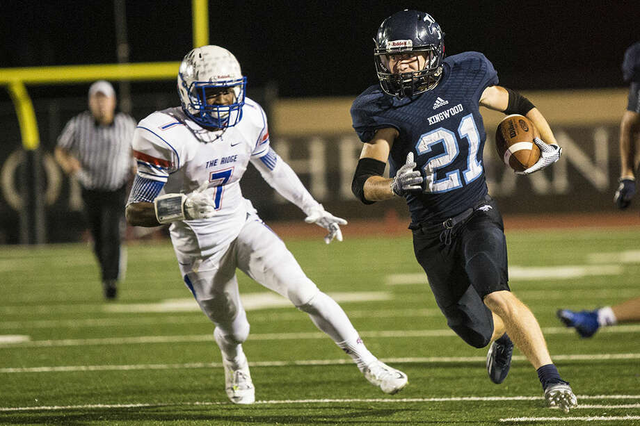 Mustangs running back Griffin Lay (21) breaks up the field during Kingwood's 26-30 loss to Oak Ridge on Sept. 26, 2014, at Turner Stadium. Photo: ANDREW BUCKLEY