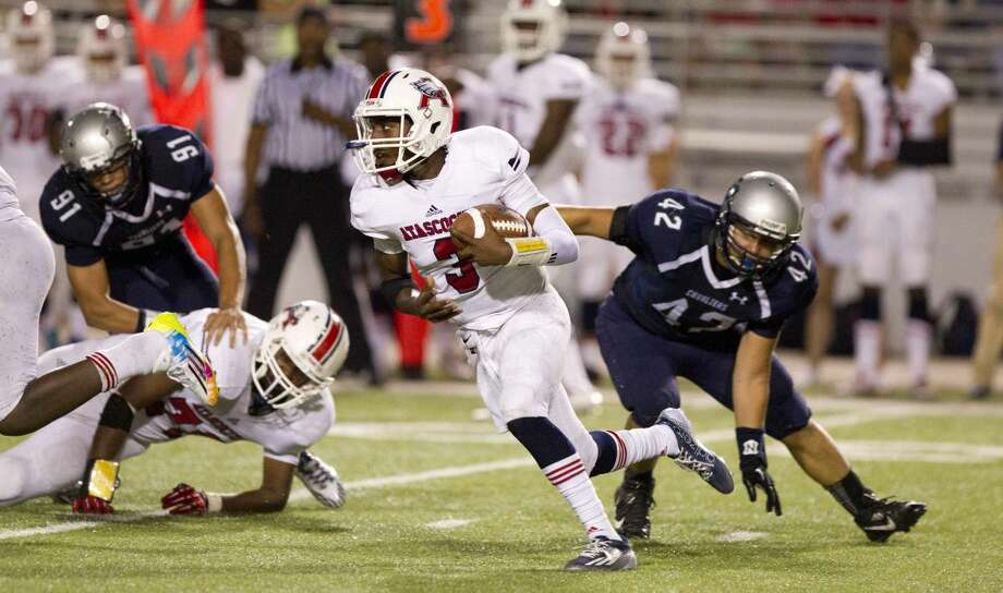 Atascocita quarterback Niyl Campbell avoids a tackle by College Park linebacker David Magalee during a high school football game at Woodforest Bank Stadium. To view or purchase this photo and others like it, visit HCNpics.com. Photo: Jason Fochtman