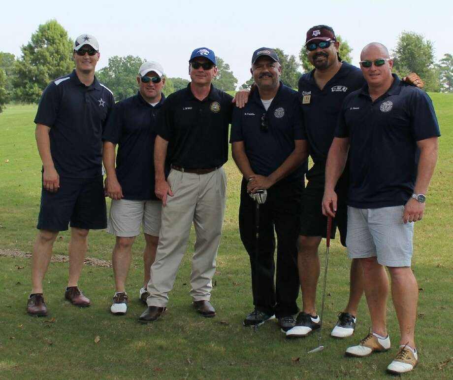 Members of the Pearland Police Department's golf team at the 2014 tournament.