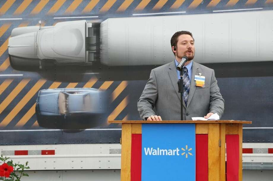 Wal-Mart store manager Daniel Parks gives a speech at the grand opening of the new location off Riley Fuzzel Road.