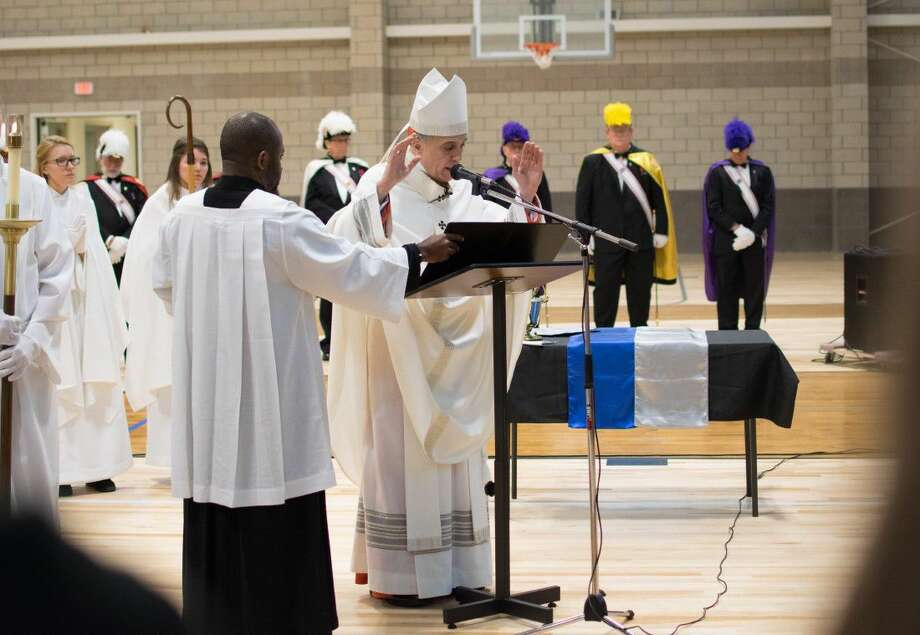 Cardinal Daniel DiNardo, archbishop of Galveston-Houston, blesses Frassati Catholic High School's new Student Life Building on May 2 at the school's campus in Spring. Photo: Frassati Catholic High School